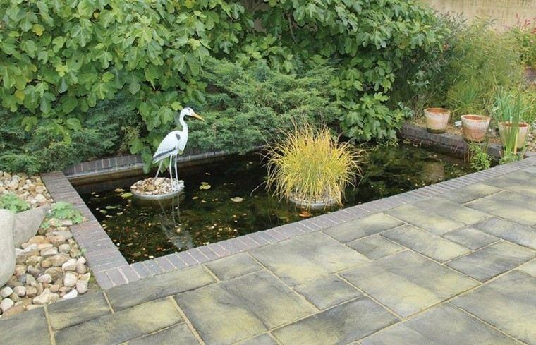 jardin estanque piedras losas plantas ideas