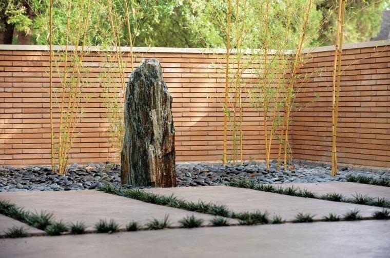 jardin guijarros losas grandes bambu valla ladrillo ideas
