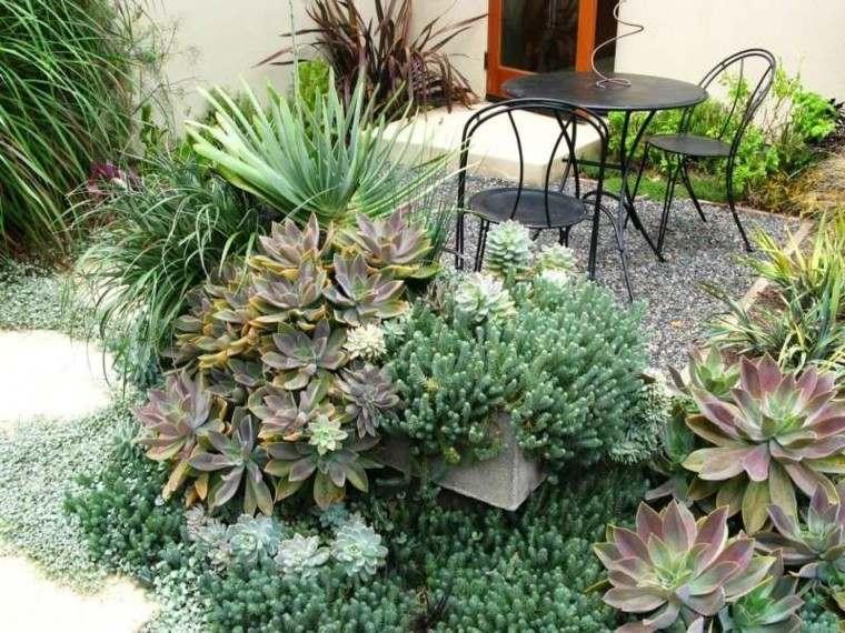 jardin guijarros mesa sillas acero negro ideas