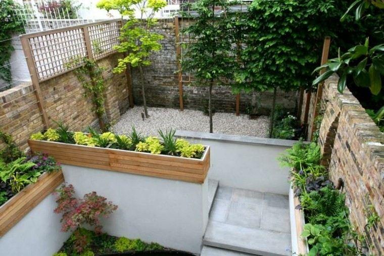 jardin guijarros nivelado muralla hormigon ideas