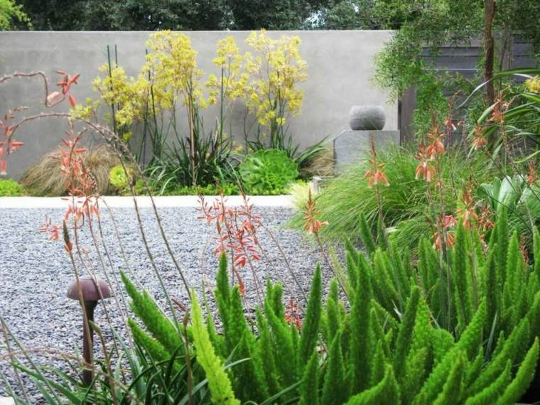 jardin guijarros plantas valla hormigon ideas