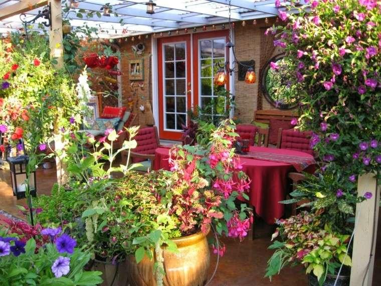 jardin tropical copioso pergola colgante plantas
