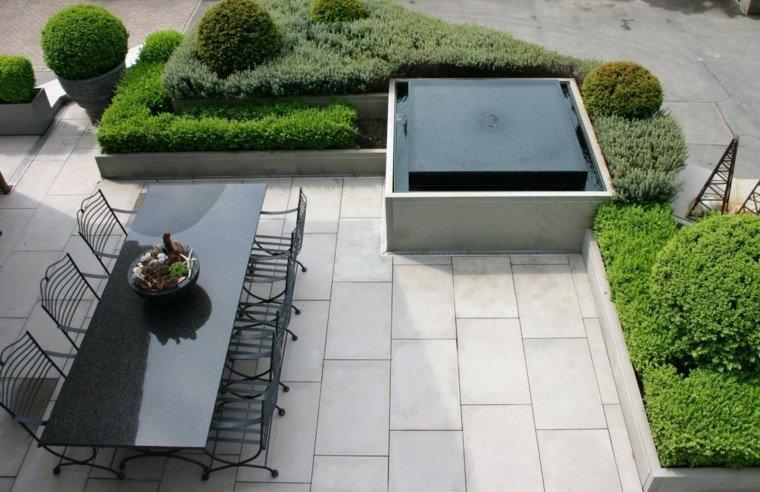 jardines y terrazas mesa encimera cuarzo negra sillas acero ideas