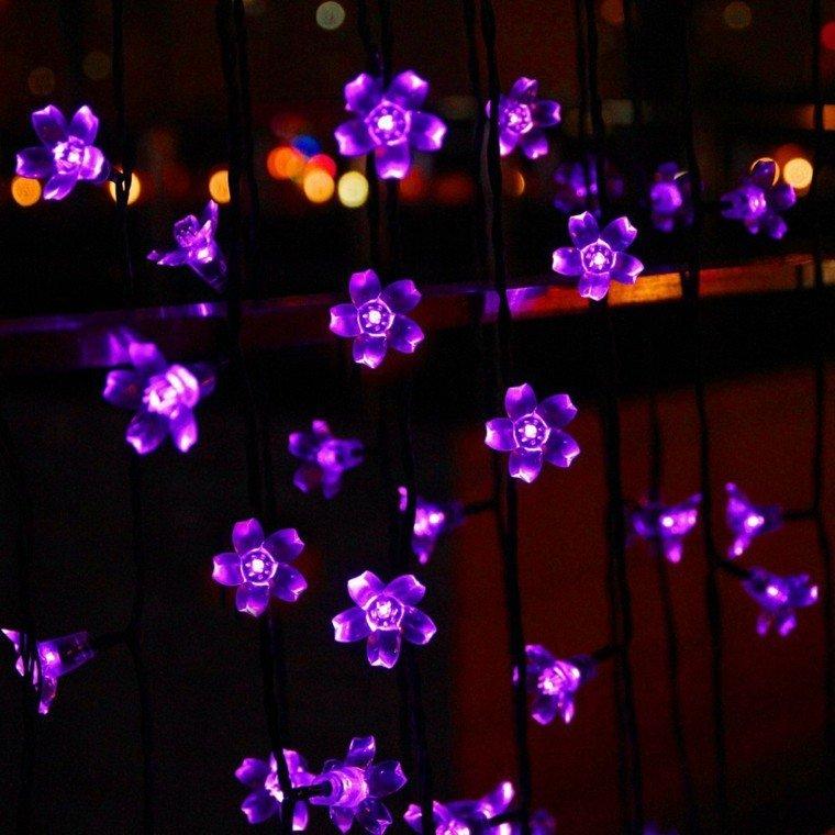 luces jardin flores violetas moradas