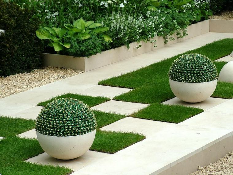 minimalista decoracion grava esferas jardineras