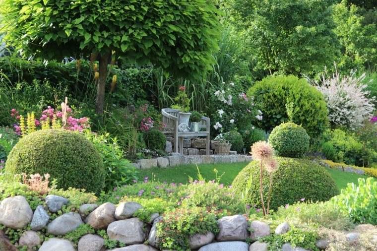 muro piedras distinto tamanos jardin plantas banco ideas