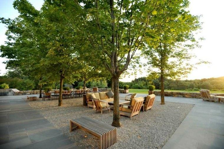 paisajes bonitos jardin guijarros banco muebles madera ideas