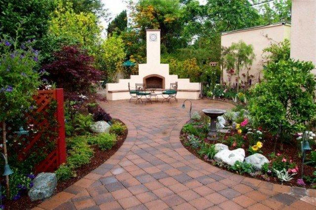 patio baldosas chimenea jardin reja