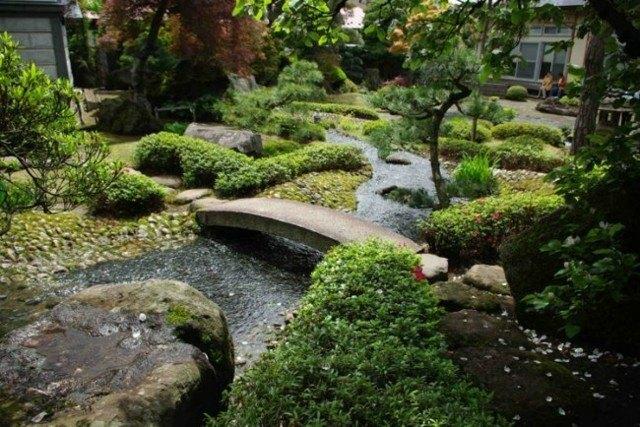 puente piedra rio estanque jardin