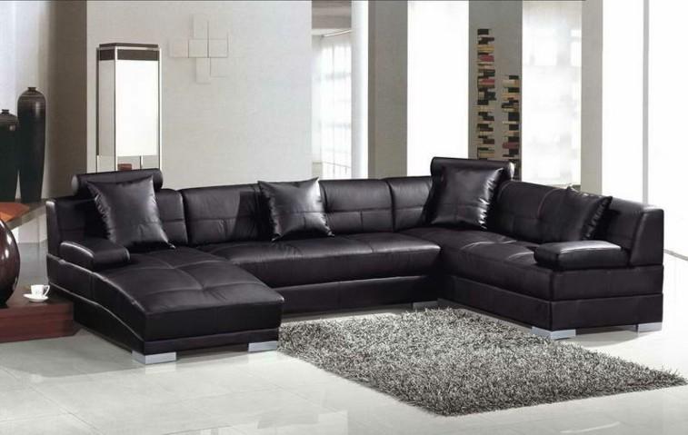 salon blanco sofa negro piel