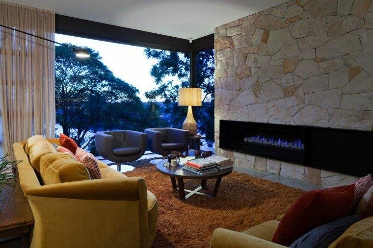 salones diseño fuego rocas pared decorada