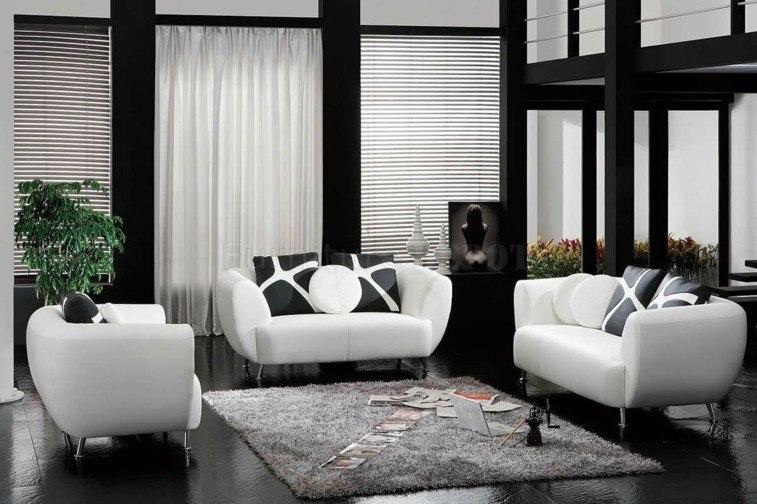 sillones blancos cojines negros salon