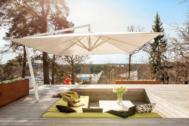 terraza asientos inferior pinos sombrilla