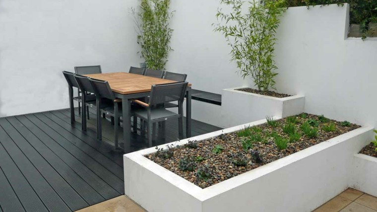 terraza madera creativo jardinera blancas