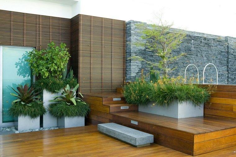 terraza madera rocas muro plantas