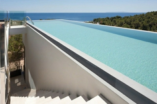 Piscinas de dise o moderno 75 ideas fabulosas for Piscina infinita construccion