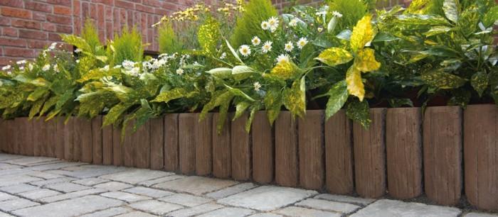 Vallas de jard n de estacas de madera empalizadas - Plantas para vallas ...
