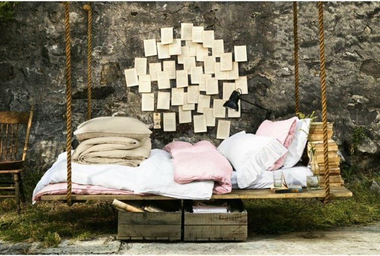 cama colgante madera cuerdas libros
