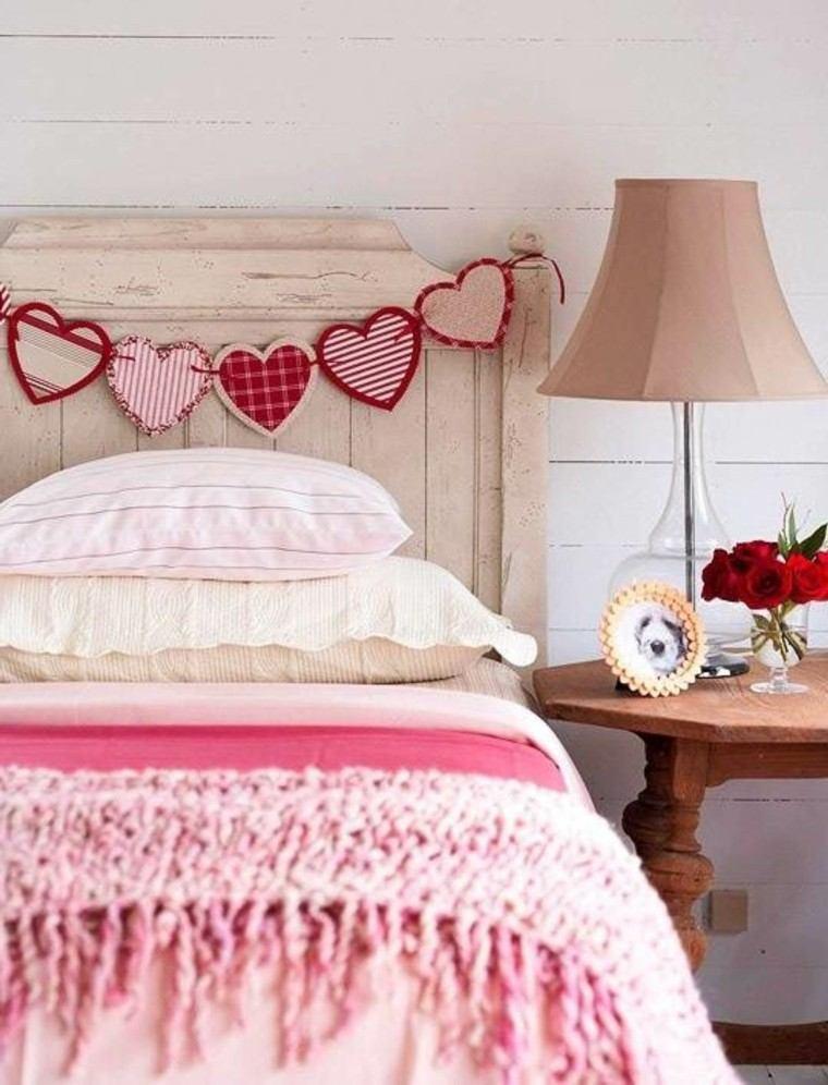 cama corazones rosa flores tejido