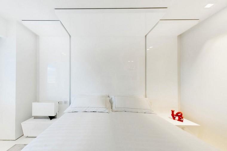 cama cabecero dormitorio penthouse blanca