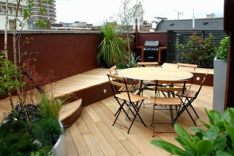 cocina exterior madera suelo sillas