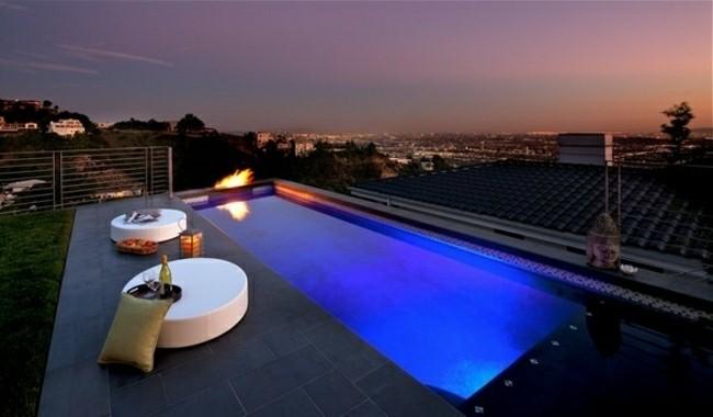 construccion de piscinas chimenea fuego