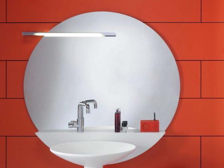 detalle pared naranja lavabo redondo