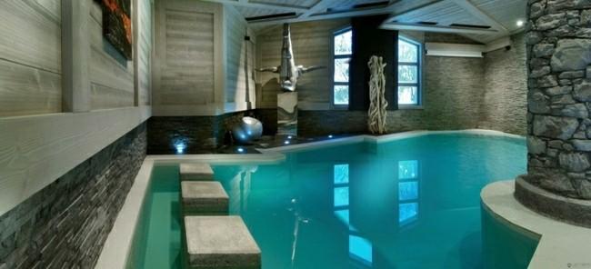 diseño piscina interior cubierta piedra