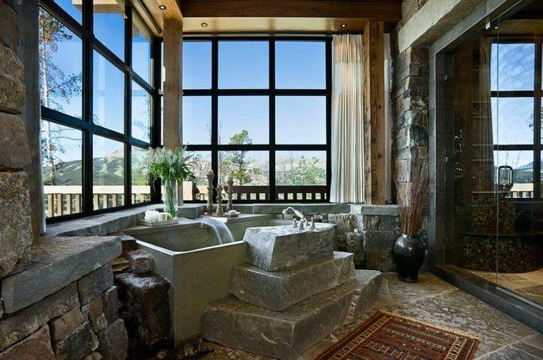 diseño baños rusticos rocas cascada flores