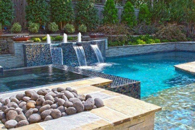 diseño piscina fuente piedras