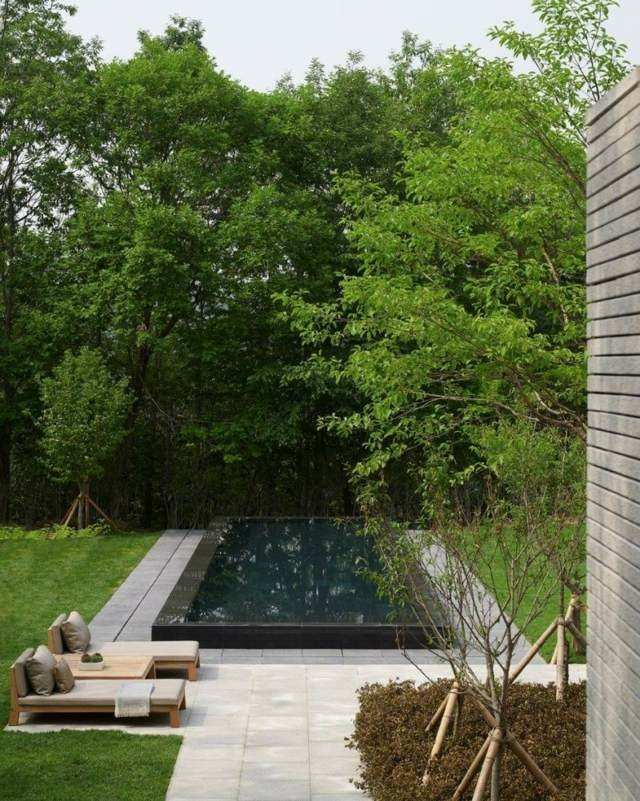 diseño piscina negra marmol