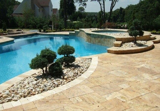 diseño piscina moderna islas plantas