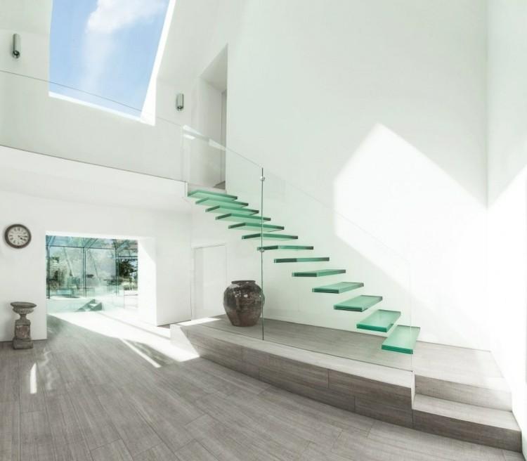 escalera minimalista moderna transparente jarron - Escaleras Voladas