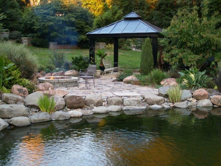estanque pergola sillas exterior rocas estanque
