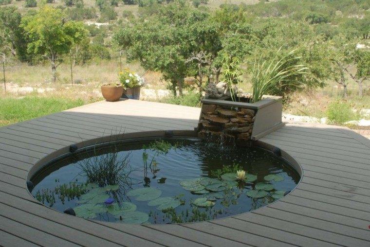 estanque redondo plataforma madera cascada