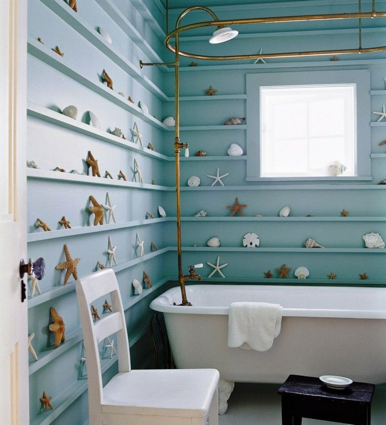 estrellas mar decorando pared azul bano ideas