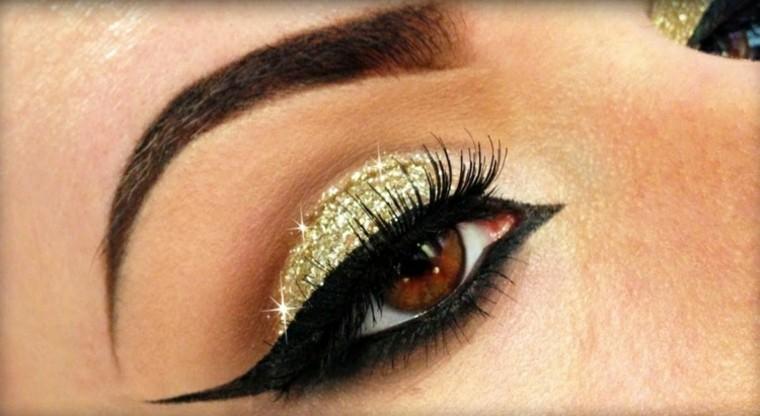 extravagante dorado ojos maquillage perlado