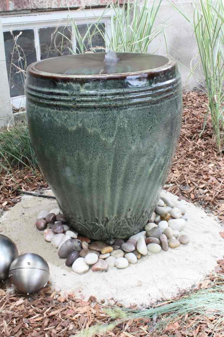 fuente forma jarra verde agua