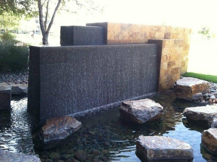 fuente moderna cascada rocas muro
