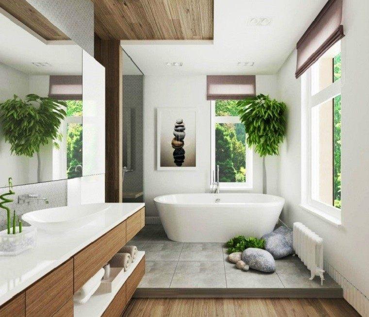 Baños Elegantes Modernos:Lavabo de granito y espejo grande en el baño al estilo minimalista