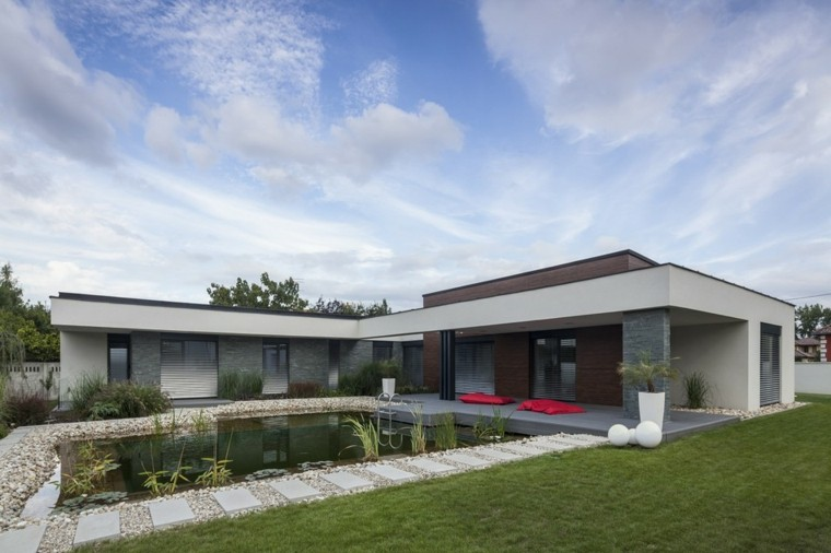 jardines diseño casa moderna cesped cojines