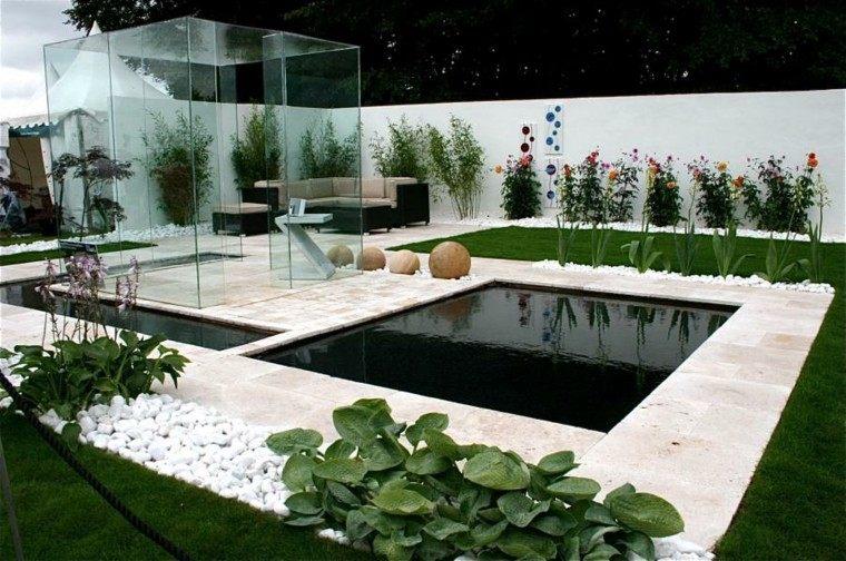 jardines diseño cesped rocas blancas moderno