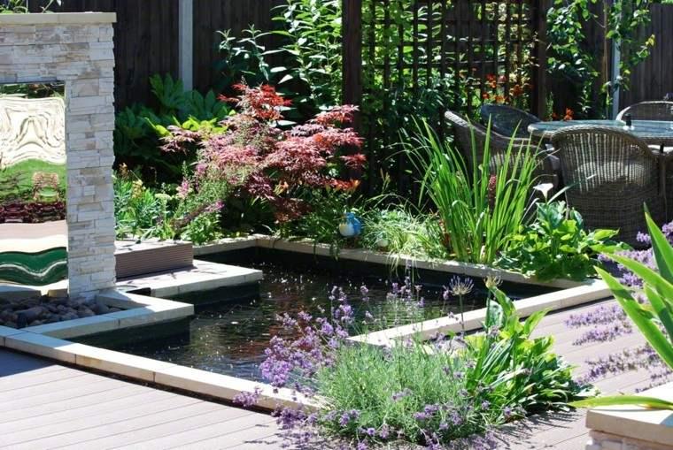 jardines diseño muro rocas flores patio