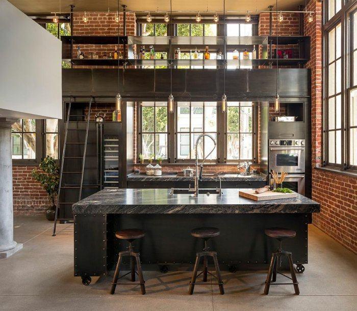 paredes cocina ladrillo visto muebles acero