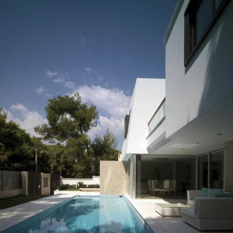 patio estilo moderno dificio blanco