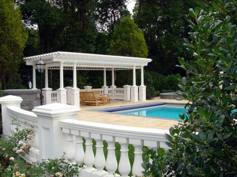 white pergola bushy gardens outdoor living room