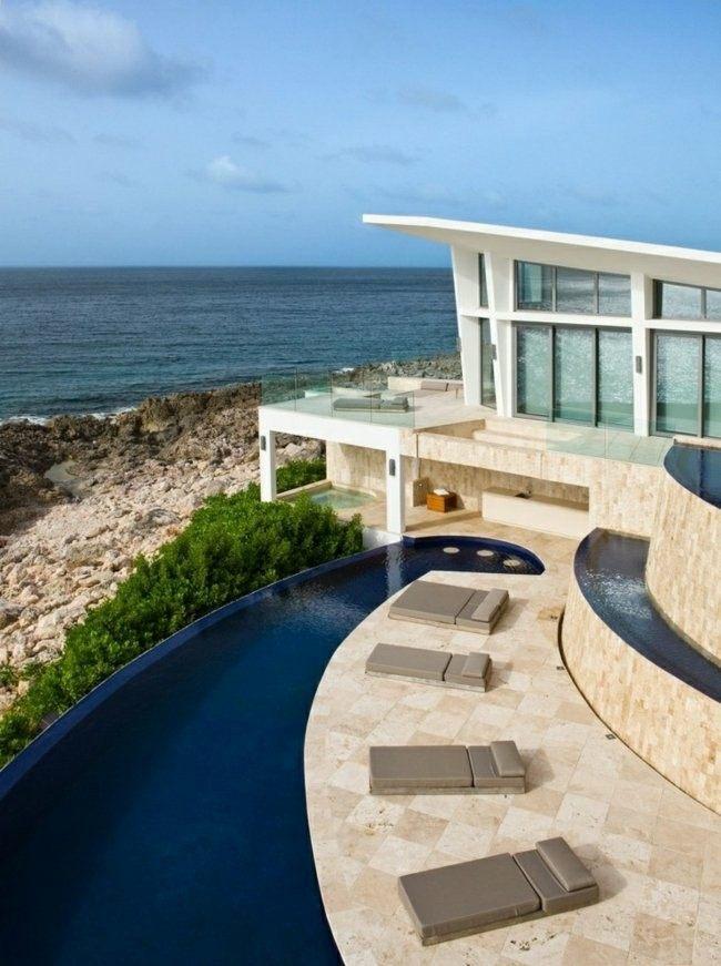 piscina forma rio vistas mar