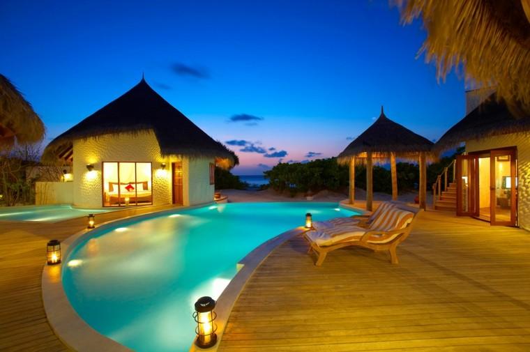 piscina exotica casetas madera vistas