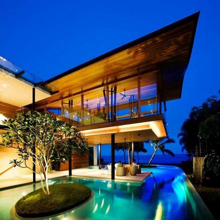 piscina isla arbol cesped vistas