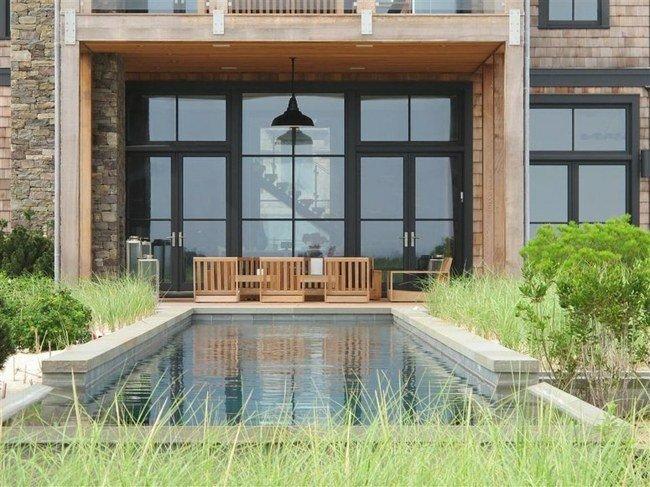 piscina moderna muebles madera sillas